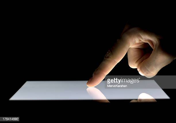 Hand pointing finger on digital PC tablet
