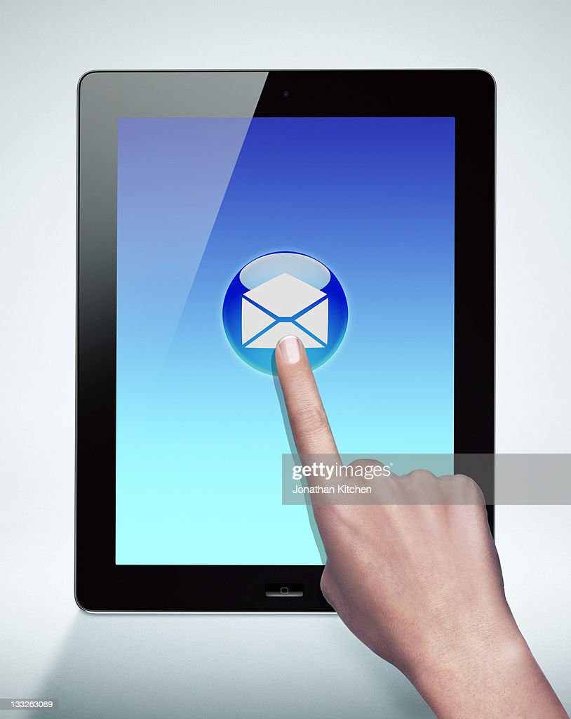 hand pointing to mail symbol on tablet computer
