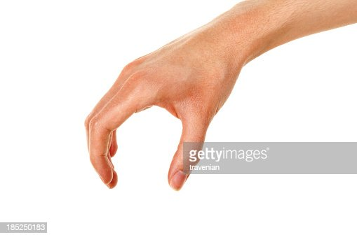 Hand positioned to pick up an object