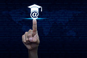 Hand pressing e-learning icon over computer binary code blue background, Study online concept