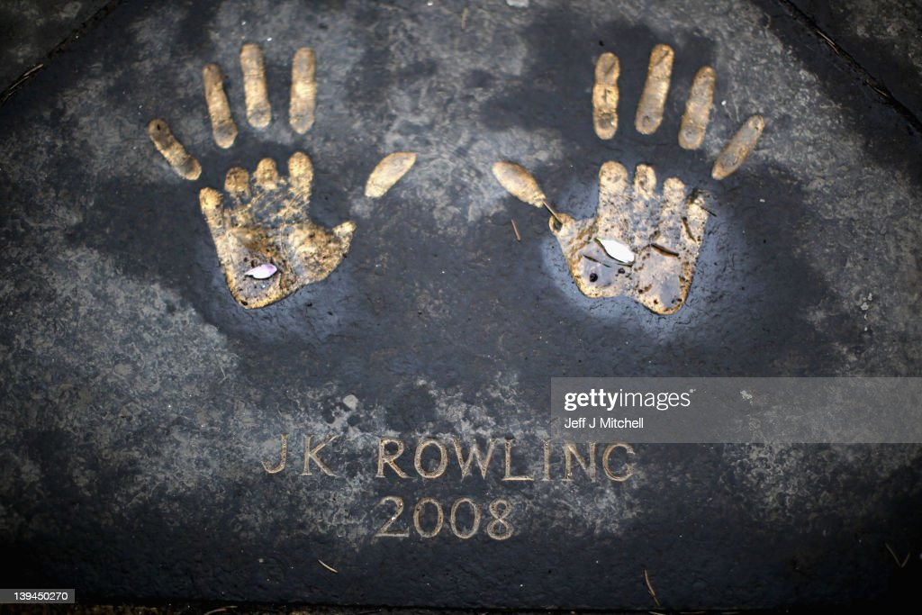 Hand prints of author JK Rowling on the Royal Mile on February 21, 2012 in Edinburgh, Scotland. A favourite with visitors and one of the busiest streets in the city, the Royal Mile runs from Edinburgh Castle at the top down to Holyrood Palace at the foot.