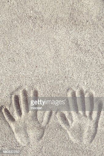 Hand prints on the sand : Stock Photo