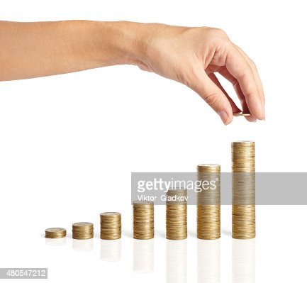 Hand put coins to stack of coins : Stock Photo
