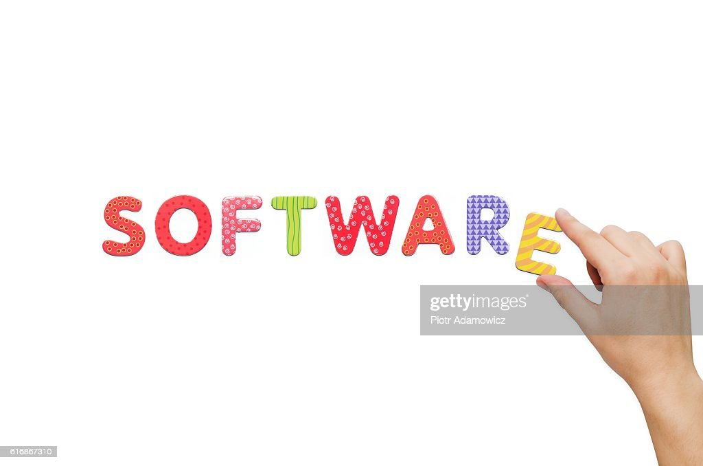 Hand put the word Software with magnetic letters : Stock Photo