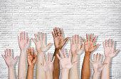 Hand Raised on Brick Wall