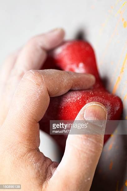hand reaching climbing hold