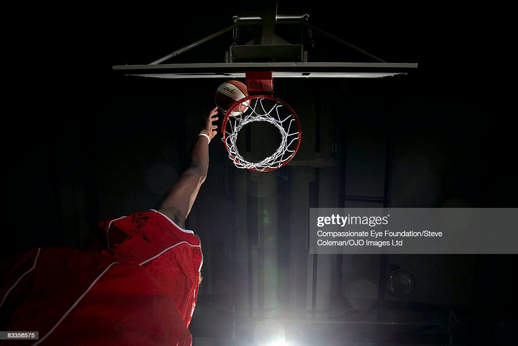 Hand reaching high for the basket : Stock Photo