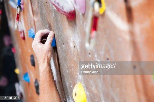 Hand Reaching on Climbing Wall