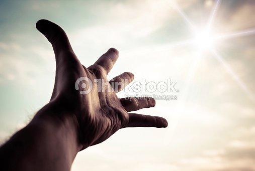 Hand reaching to towards sky. : Stock Photo