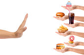 Hand refusing junk food or fast food with white background
