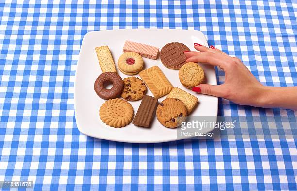 Hand removing biscuit from plate