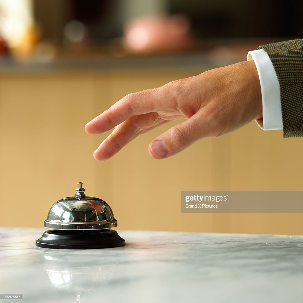 Hand ringing service bell : Stock Photo