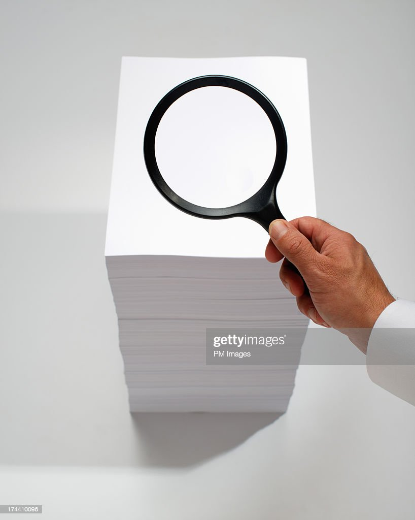 Hand searching with magnifying glass