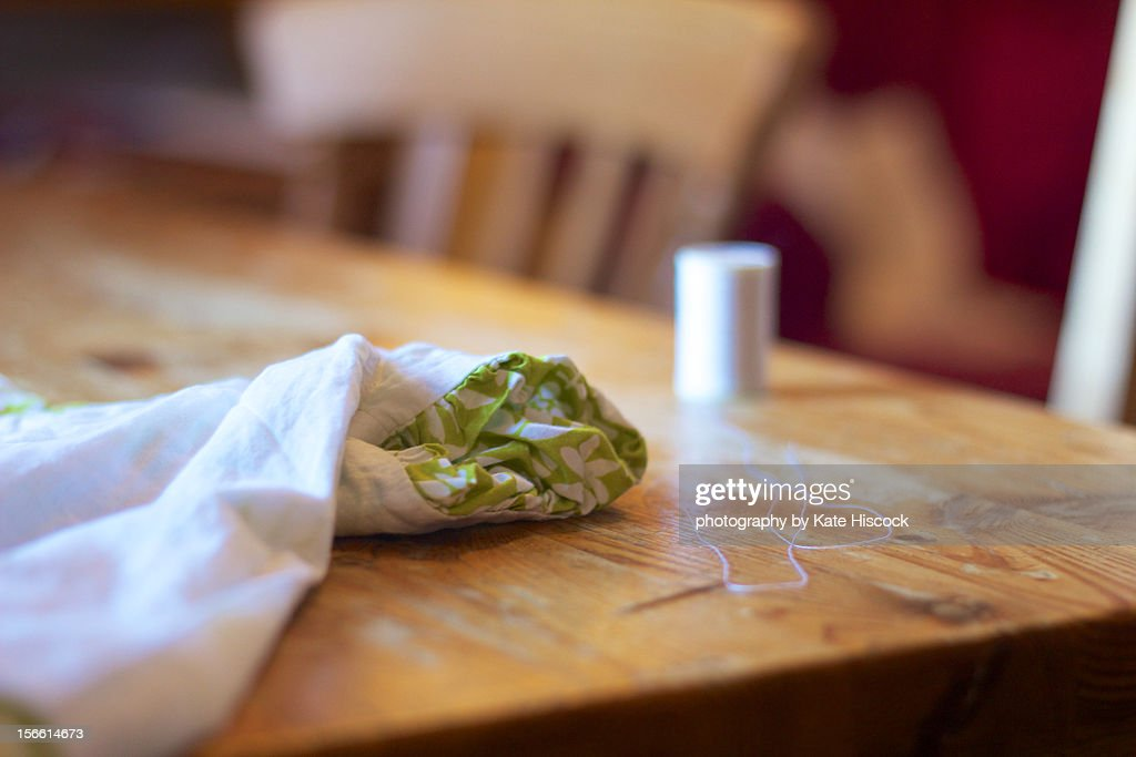 Hand sewing at the table : Stock Photo