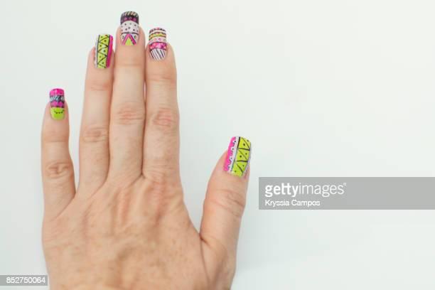Hand showing design nail art