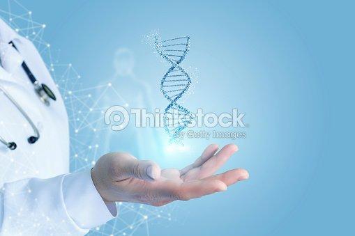 Mano con ADN. : Foto de stock
