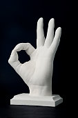 Statue of a man hand with OK gesture