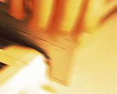 Hand sliding credit card in reader, close up, blurred motion