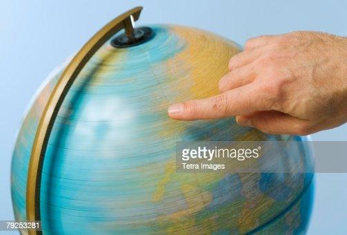 Hand spinning globe