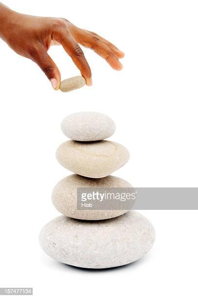 hand Stapeln Steine auf einem Stein tower