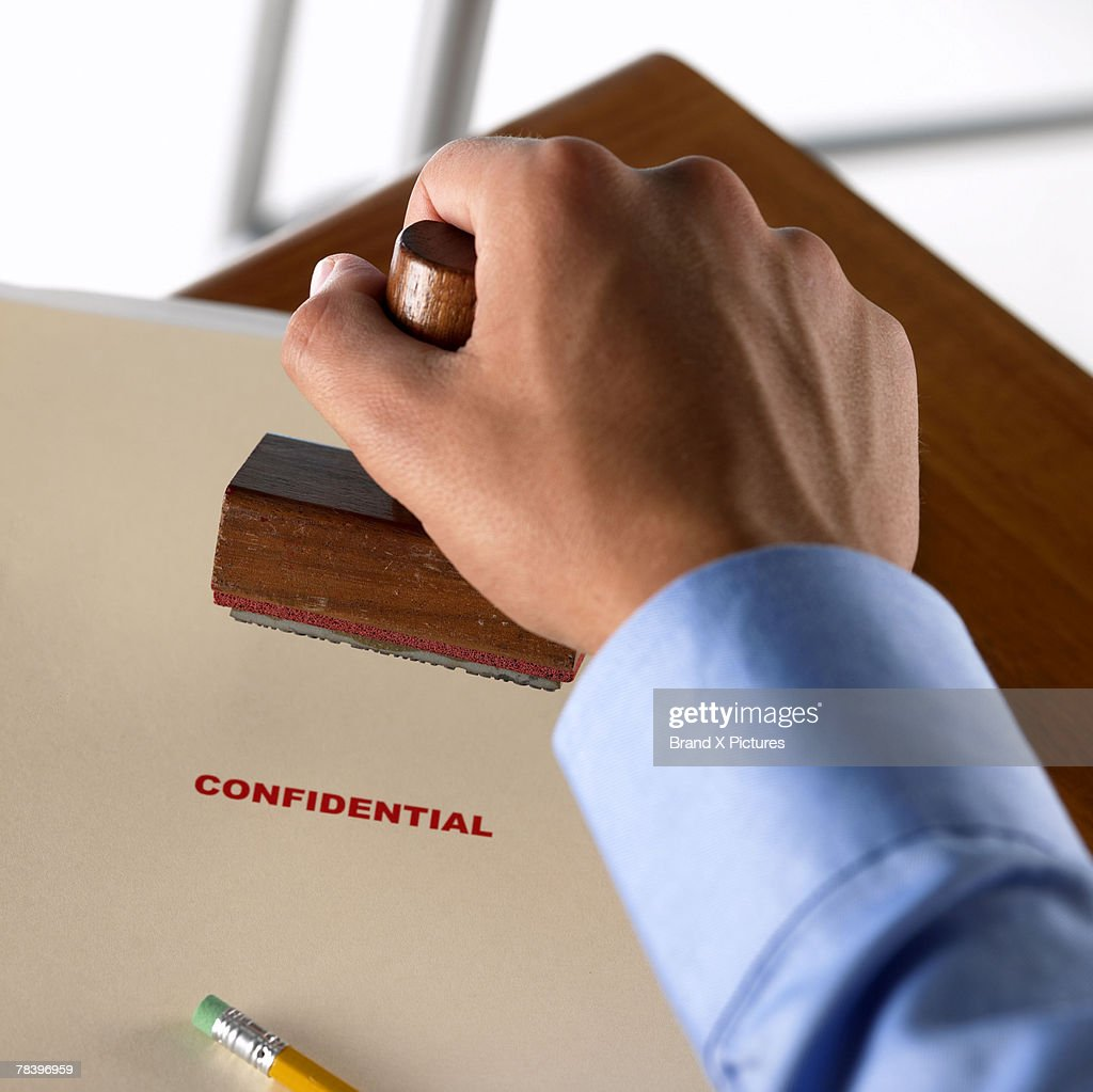 Hand stamping confidential documents