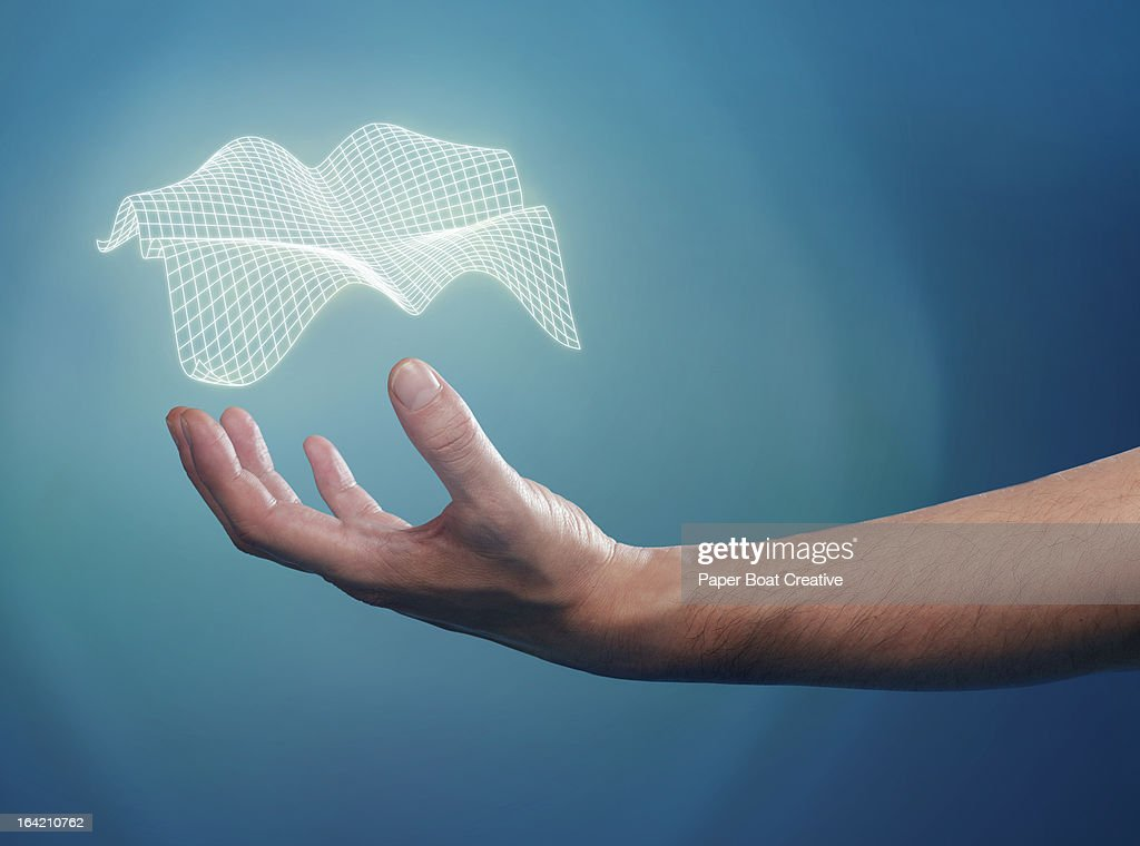 Hand supporting a floating 3D grid over his palm : Stock Photo