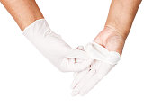 Hand throwing away white disposable gloves medical, Isolated on white background, Save clipping path. Infection control concept.