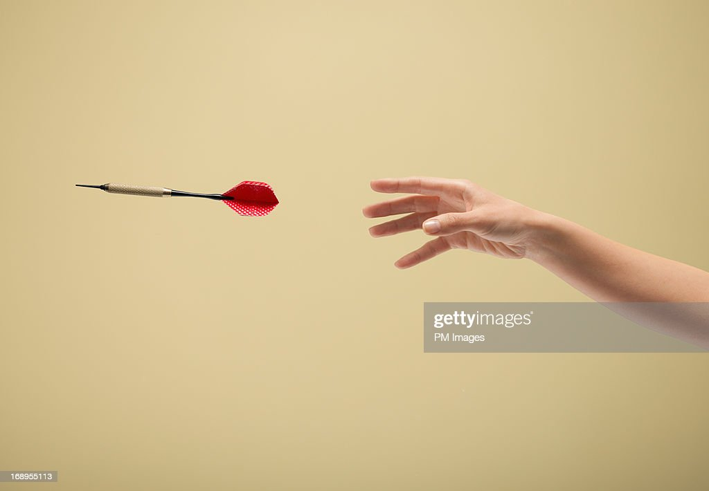 Hand throwing dart