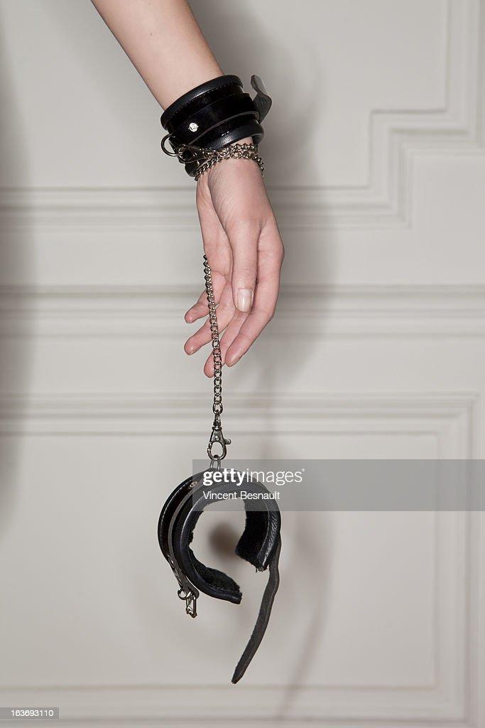 A hand tied handcuffs.