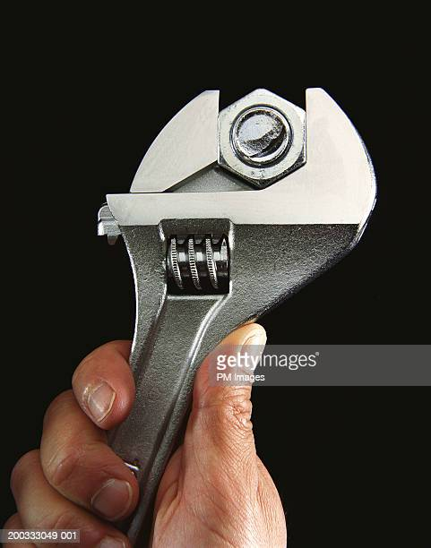 Hand tightening nut and bolt with wrench