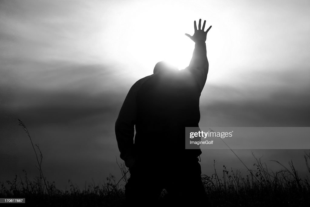 Hand to Heaven in Worship With God Rays : Stock Photo