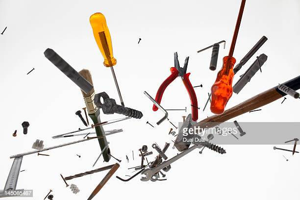 Hand tools and equipment against a white background