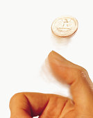 Hand tossing coin