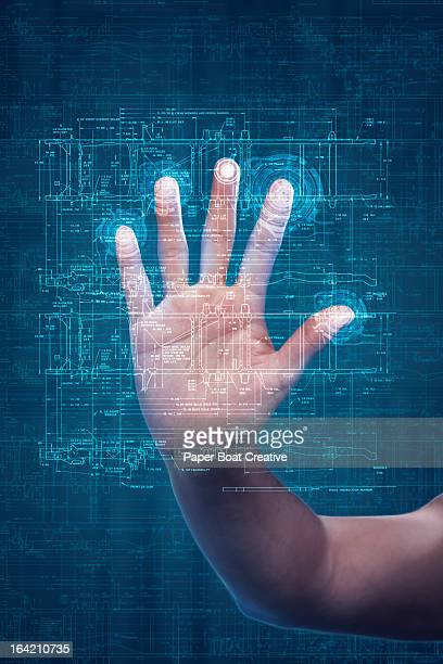 Hand touching digital scanner in studio background