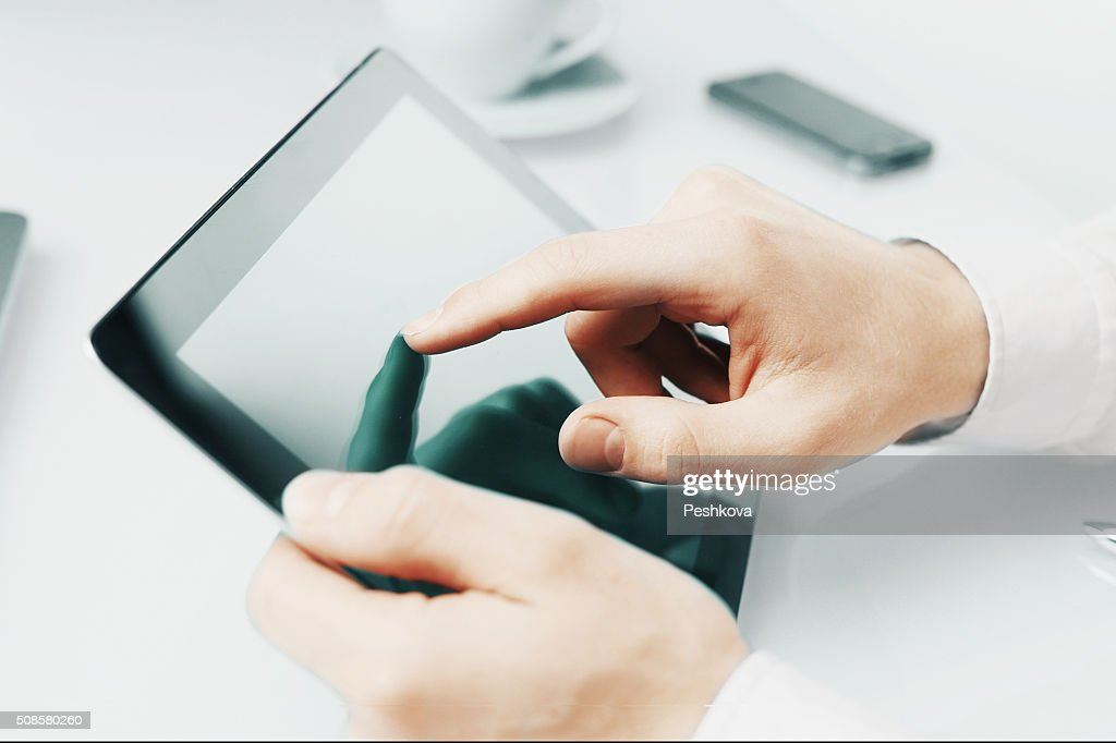 hand touching digital tablet : Bildbanksbilder