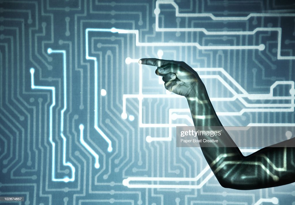 hand touching light projection of microchip : Stock Photo