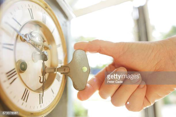 Hand turning key in clock