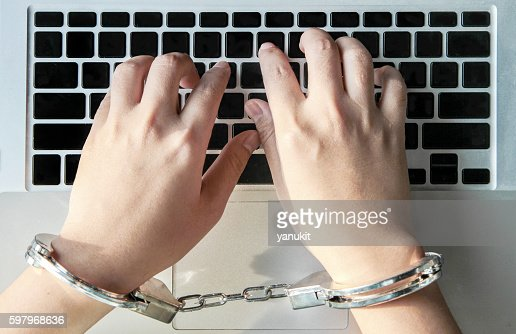 hand type computer laptop for crime : Stock Photo