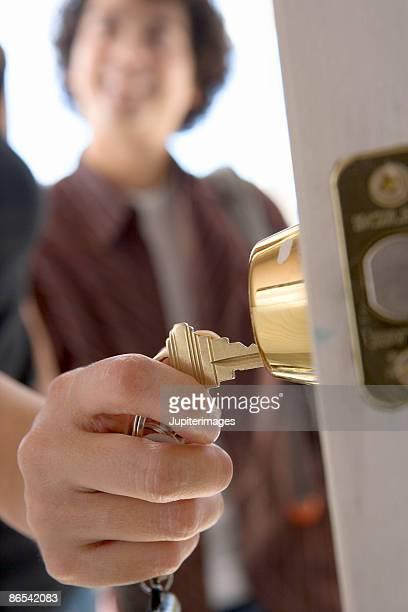 Hand unlocking front door