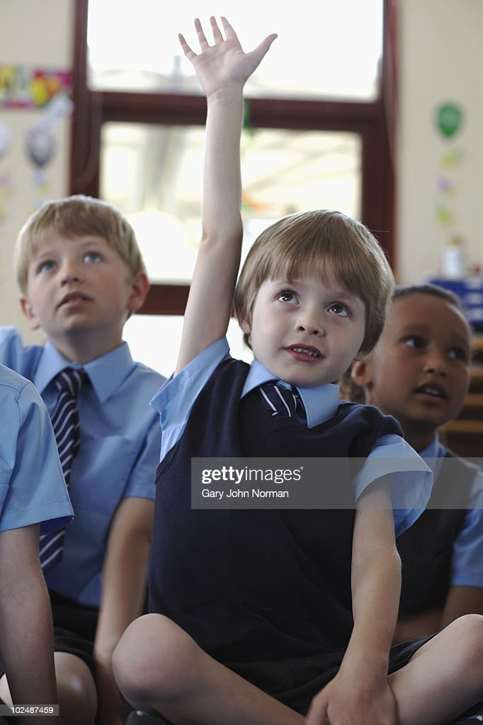 Hand up young student  : Stock Photo