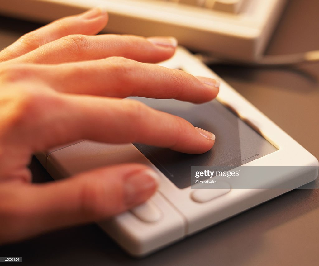 Hand using touch pad mouse : Stock Photo
