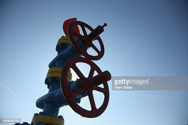 Hand wheels valves and metal flame stand at a memorial to the first natural gas fields in Ukraine drilled in the 1920s when the area was part of...