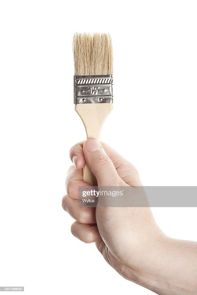 Mão com um Pincel : Foto de stock
