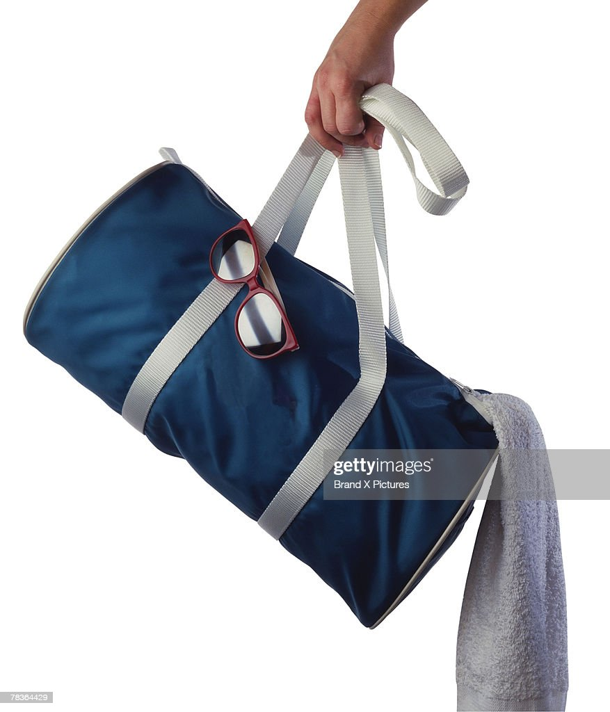 Hand with a gym bag : Stock Photo