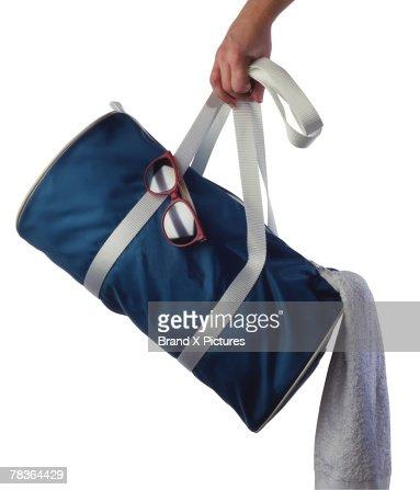 Hand with a gym bag