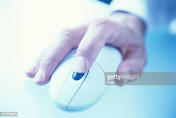 hand with a pc mouse
