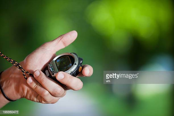 Mano con un cronometro
