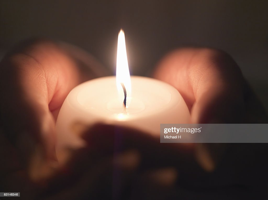 Hand with candle that attaches fire : Stock Photo