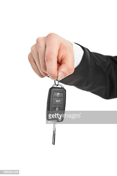 hand with car keys