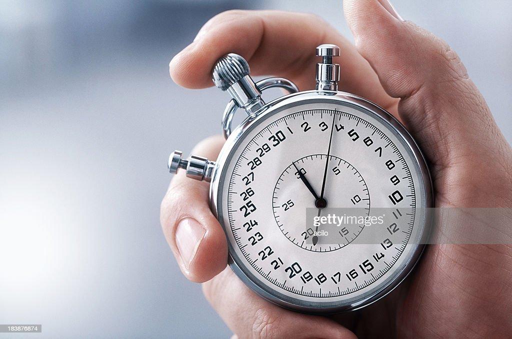 Main avec chronomètre classique : Photo